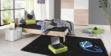 hippes Schlafzimmer mit einfachem Bett.jpg